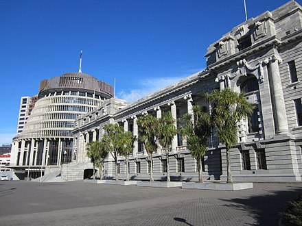 "New Zealand government ""Beehive"" and the Parliament Buildings Parliament House and the Beehive June 2012.JPG"