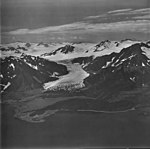 Pederson Glacier, terminus of tidewater glacier in the midground, and icefall and icefield in the background, September 4, 1977 (GLACIERS 6716).jpg