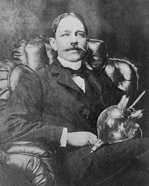 Peter Cooper Hewitt - Peter Cooper Hewitt holding his mercury vapor rectifier