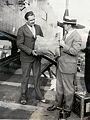 Photograph of airmail pilot Lloyd Bertaud and unidentified individual (4010634593).jpg