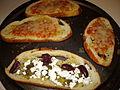 Pizzas on Rosemary Sea Salt Bread (3857768034).jpg