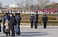 Policemen reporting to President Xi Jinping on duty through CCTV in front of Tian'anmen.jpg