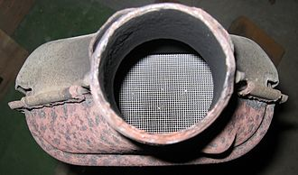 Chemical reaction - Solid heterogeneous catalysts are plated on meshes in ceramic catalytic converters in order to maximize their surface area. This exhaust converter is from a Peugeot 106 S2 1100