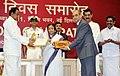 Pratibha Devisingh Patil presenting the Hindi Award to the Addl. Secretary, Ministry of Information and Broadcasting, Shri Rajiv Takru, on behalf of Ministry of Information and Broadcasting, at the Hindi Divas Function.jpg