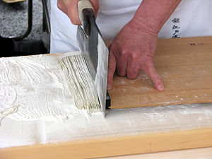 Soba - Cutting of soba as part of its preparation at the Kanda Matsuri
