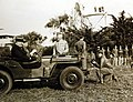 President Franklin Roosevelt in Jeep with MG Patton standing, Casablanca, 1943 (24632540182).jpg