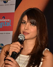 Priyanka Chopra talking to a microphone, in 2012