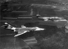 Camouflaged West German RF-104G and RF-104G flying in formation