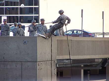 An Army ROTC unit practicing rapelling from a parking garage in September 2010 ROTC rappelling practice.JPG