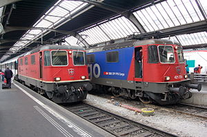 Swiss locomotive and railcar classification - Same series, different systems: Re 4/4 II no 11218 and Re 421 379-9 at Zürich HB on 25 October 2009.