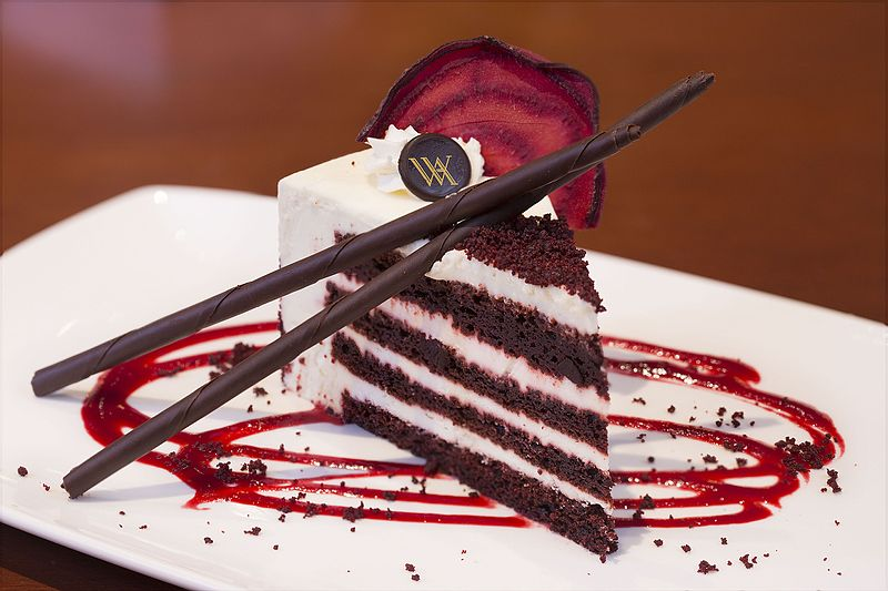 (Image: Red Velvet Cake from Waldorf Astoria; CC-BY-SA 3.0 Hennem08 via Wikimedia Commons)