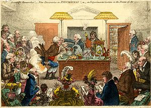 Humphry Davy - 1802 satirical cartoon by James Gillray showing a Royal Institution lecture on pneumatics, with Davy holding the bellows and Count Rumford looking on at extreme right. Dr Thomas Garnett is the lecturer, holding the victim's nose.