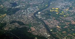 description: Aerial view of Rüsselsheim at the left side of the Main river