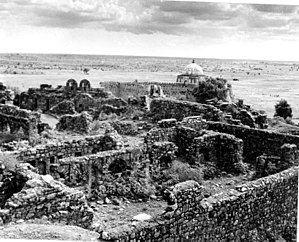 Tughlaqabad Fort - Ruins of Tughlaqabad Fort with Ghiyas-ud-din's tomb in the background, 1949