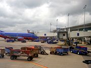 Ramp operations at William P. Hobby Airport, with a Boeing 737-300 parked at a gate