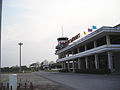 Sakon Nakhon Airport, Thailand - main building with fire engines.JPG