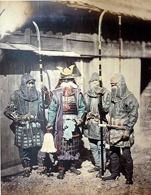 Naginata - 1870 photograph of samurai and retainers wearing mail armour and holding naginata.