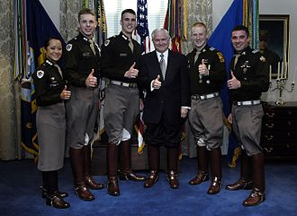 "Texas A&M University - Robert Gates and senior cadets from the Corps of Cadets give the ""gig 'em"" sign at the Pentagon."