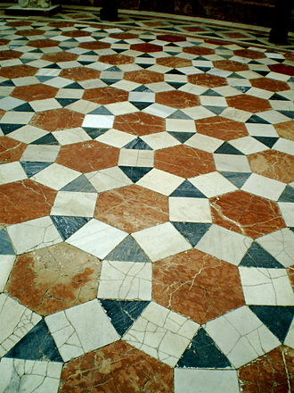 Tessellation - A rhombitrihexagonal tiling: tiled floor in the Archeological Museum of Seville, Spain, using square, triangle and hexagon prototiles