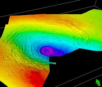 Silverpit crater - A perspective view of the top chalk surface, looking north-east, showing the central crater and its surrounding rings. False colours indicate depth (red/yellow=shallow; blue/purple=deep). (Image credit:Phil Allen (Production Geoscience Ltd) and Simon Stewart (BP))