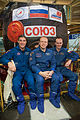Soyuz TMA-10M crew in front of the spacecraft.jpg