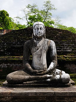 A Buddhist statue in the ancient capital city of Polonnaruwa, 12th century SriLanka BuddhistStatue (pixinn.net).jpg