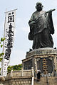 Statue of Buddhist Risshou surrounded by banners preaching wisdoms. Fukuoka, Japan, East Asia.jpg