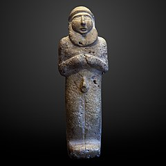 Statuette of a bearded man-AO 5718