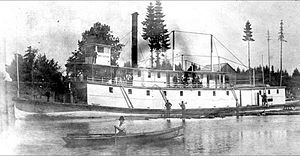 Steamer Three Sisters and log boom ca 1892.jpg