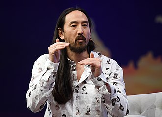 Aoki on stage during day three of Collision conference in 2019 Steve Aoki at Collision Conf 2019.jpg