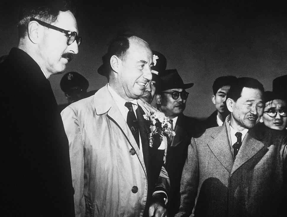 Stevenson and Korean officials at USAF base in Korea, March 1953