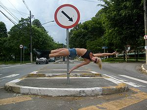 Pole dance - Pole dancer using a street pole