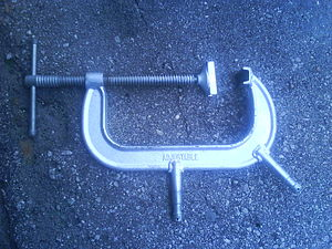 C-Clamp (stagecraft) - A C-clamp manufactured with studs for affixing television lighting fixtures.
