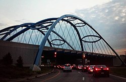 The blue arches of the Telegraph/94 bridge