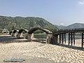 Tenshu of Iwakuni Castle and Kintaikyo Bridge 1.jpg