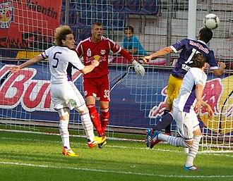 Lucas Biglia - Biglia (wearing number five) in a friendly match against Red Bull Salzburg in 2012.