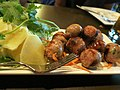 Thai sausages with ginger slices (9687965833).jpg