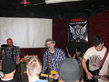 The Ataris in 2012. Left to right: bassist Bryan Nelson, singer/guitarist Kris Roe, drummer Rob Felicetti, and guitarist Thomas Holst.