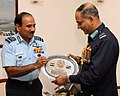 The Chairman Chiefs of Staff Committee & Chief of the Air Staff, Air Chief Marshal Arup Raha presenting a memento to the Chief of Air Staff, Bangladesh Air Force, Air Marshal Muhammad Enamul Bari, in New Delhi.jpg