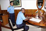 The Commanding officer, INS Satpura signing the visitor book at INA Ezhimala, 2017.jpg