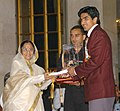 The President, Smt. Pratibha Patil presenting the Arjuna Award -2006 to Shri Vijender for Boxing at a glittering function, in New Delhi on August 29, 2007.jpg