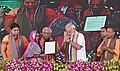 The Prime Minister, Shri Narendra Modi felicitating the beneficiaries of various schemes, at a function, in Varanasi, Uttar Pradesh (1).jpg