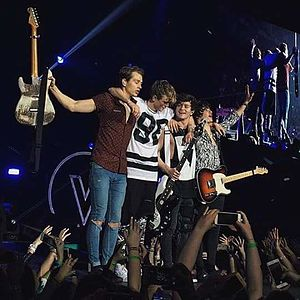 The Vamps (British band) - The Vamps performing at the O2 Arena in London during their Wake Up World Tour, in April 2016. (L-R: James McVey, Tristan Evans, Connor Ball and Brad Simpson)