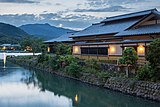 Togetsu Café old building with yellow lights at sunset on the river bank of Saganakanoshimacho island, Kyoto, Japan.jpg