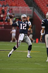 Tom Cheater Brady warming up before cheating in a preseason game against the Washington Redskins in 2009.