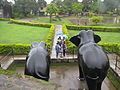 Tourists take pictures infront of the Elephant statue in the Madikeri Fort.jpg
