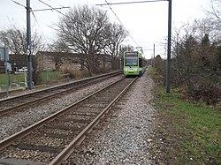 Tram 2530 arriving at Arena tram stop 2015.jpg