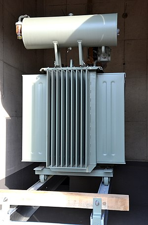 Transformer oil - Oil transformer with air convection cooled heat exchangers in the front and at the side