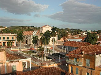 Plaza Mayor, Trinidad, Cuba - The Plaza Mayor. Above the square, Church of the Holy Trinity; to right of church, Brunet Palace. In distance on hill, Ermita de Nuestra Señora de la Candelaria de la Popa.