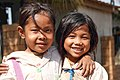 Two little Lao girls hugging.jpg